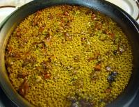 Arroz con Conejo y Caracoles Serranos